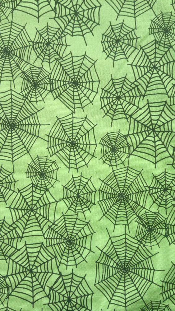Teplákovina s elastanem pavučiny na zelené