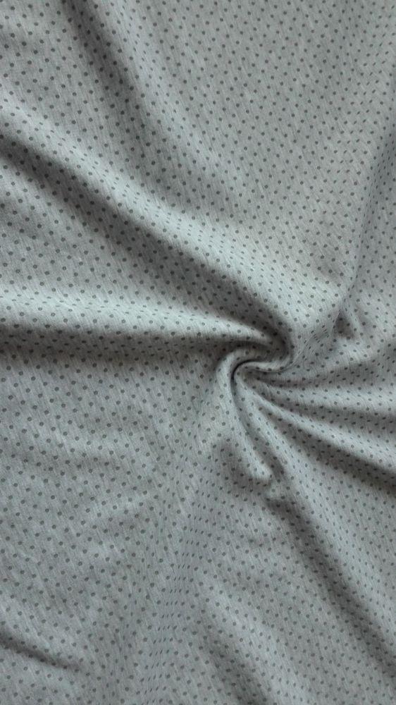 Teplákovina s elastanem šedozelené puntíky na šedém melé
